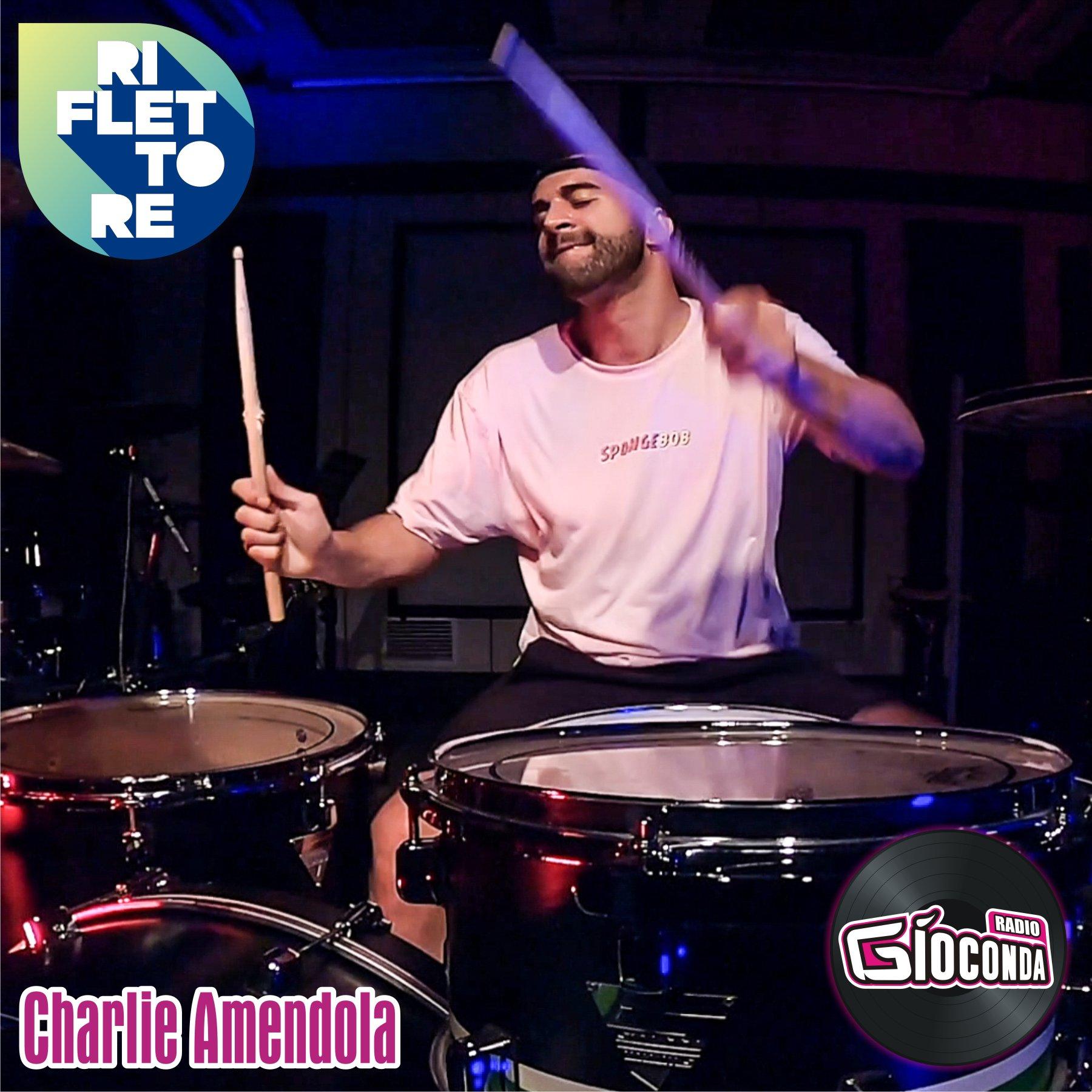Riflettore con il batterista Charlie Amendola